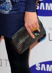 Trinny Woodall toted a stylish snakeskin clutch at the Samsung 3D television launch.