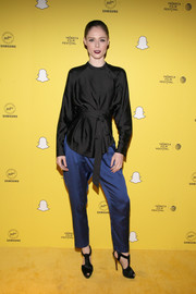 Coco Rocha completed her outfit with a pair of blue silk pants.
