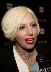 Lady Gaga sealed off her look with a stunning diamond chandelier necklace by Jacob & Co.