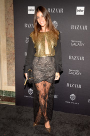 Julia Restoin-Roitfeld went for eclectic glamour at the Harper's Bazaar Icons event in a multitextured Alessandra Rich dress with peekaboo detailing on the bodice.