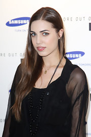 Amber Le Bon went all black at the Samsung Galaxy S launch as she styled her dress with a multi-layered beaded necklace.