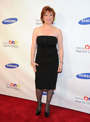 Caroline Manzo completed her elegant black ensemble with a pair of patent leather platform pumps.