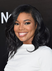 Gabrielle Union topped off her look with a glossy pout.