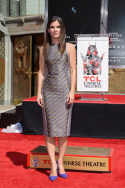 Sandra Bullock looked ageless in a vintage-chic printed sheath during her hand and footprint ceremony.