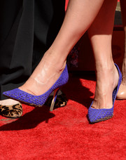 Sandra Bullock didn't mind getting her purple Jimmy Choos dirty during her hand and footprint ceremony.