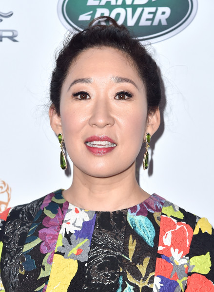 Sandra Oh Loose Bun [hair,eyebrow,hairstyle,chin,lip,forehead,black hair,smile,ear,eyelash,arrivals,sandra oh,tea party,los angeles,beverly hills,california,the beverly hilton hotel,bafta,bbc,america tv]