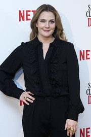 Drew Barrymore attended the 'Santa Clarita Diet' photocall in Madrid wearing a trio of gold rings.