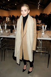 Ashley Olsen draped a nude pashmina scarf over a long trench coat at the Santa Monica Museum of Art in California.