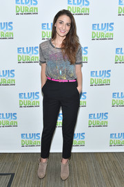 For her footwear, Sara Bareilles picked beige suede booties.
