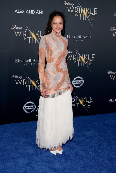 Sasha Lane Pumps [a wrinkle in time,clothing,dress,shoulder,carpet,red carpet,premiere,fashion,flooring,joint,neck,arrivals,sasha lane,california,los angeles,el capitan theatre,disney,premiere,premiere]