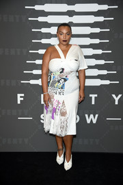 Paloma Elsesser looked fashion-forward in an asymmetrical lace-panel print dress at the Savage X Fenty show.