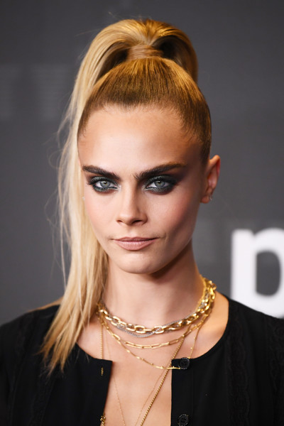 Cara Delevingne looked edgy-chic with her high ponytail at the Savage X Fenty show.