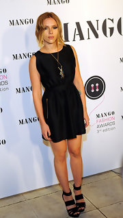 Scarlett paired her simple black dress with platform strappy heels.