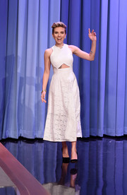 Scarlett Johansson looked trendy in a white Jonathan Simkhai dress with a midriff cutout and a diamond-patterned skirt during her 'Jimmy Fallon' appearance.