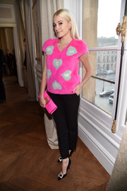 Pixie Lott paired her cute top with cropped black trousers.