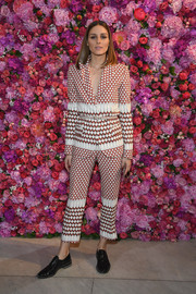 Olivia Palermo opted for a geometric-print pantsuit when she attended the Schiaparelli Couture Fall 2018 show.