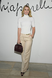 Kitty Spencer was casual and classic in a white turtleneck at the Schiaparelli Couture Spring 2020 show.