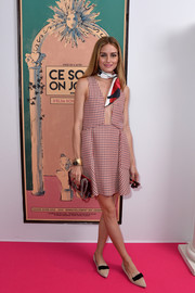 Olivia Palermo attended the Schiaparelli Couture fashion show wearing a Dior checkered mini dress with a down-to-the-navel neckline.