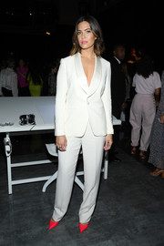 Mandy Moore was sleek and sophisticated in a white Ralph Lauren pantsuit at the Schiaparelli Couture Fall 2019 show.