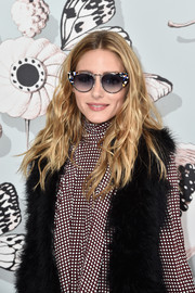 Olivia Palermo went for playful styling with a pair of colorful cateye sunnies by Wunderkind during the Schiaparelli Couture fashion show.