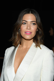 Mandy Moore swiped on some pink lipstick for a pop of color to her white look.