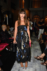 Miroslava Duma looked very summery in her spaghetti-strap print dress during the Schiaparelli Couture fashion show.