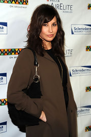 Gina Gershon accessorized with a black suede hobo bag when she attended the Cool Comedy - Hot Cuisine event.