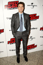 Chris Evans looked dashing in a soft blue button down shirt and grey suit.