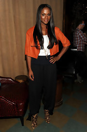 Tika Sumpter added edge to her look with leopard print wedge booties.