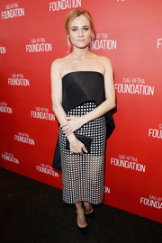 Diane Kruger pulled her look together with a studded black clutch by L.K. Bennett.