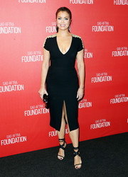 Bellamy Young wore a figure-hugging black dress with a slit in the middle and low scoop-neck.