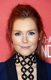 Darby Stanchfield pulled up her red locks in a messy updo with loose strands for an effortless style.