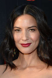 Except for a punch of red on the lips, Olivia Munn stuck to a natural beauty look during the screening of 'Deliver Us from Evil.'