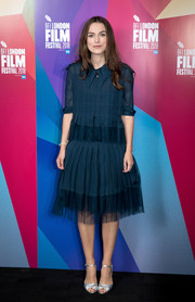 Keira Knightley attended the BFI London Film Festival Screen Talks wearing a pleated teal blouse by Chanel Couture.