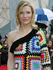 Cate will try anything once! She is wearing a colorful crocheted dress and balances the look with a simple hair cut.