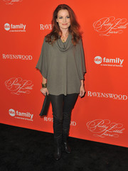 Laura Leighton was casual-chic in black leather skinnies and a cowl-neck top during the 'Pretty Little Liars' Halloween episode screening.