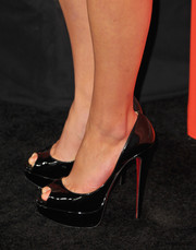 Sasha Pieterse added inches to her height with a pair of ultra-high black Christian Louboutin peep-toes during the 'Pretty Little Liars' screening.