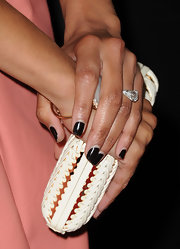 Zoe Saldana arrived at a screening of 'Columbiana' with a manicure featuring black nail polish.