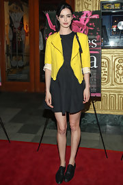 Krysten Ritter kept her red carpet look simple but chic with this basic black dress paired with a yellow blazer.