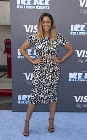 Black slim-strap sandals finished off Tia Mowry's ensemble.