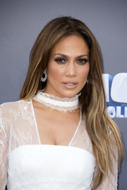 Jennifer Lopez sported a long center-parted hairstyle (and her signature parted-lip pose) at the screening of 'Ice Age: Collision Course.'