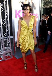 Letoya looked ready for spring in her golden satin dress. She topped off her look with a loose bun.
