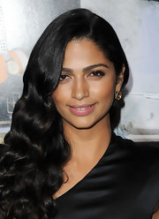 Camila Alves added contrast to her bronzed skin with petal pink lipstick.