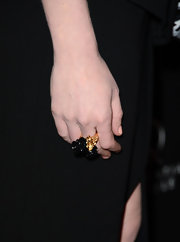 Kirsten Dunst's gold floral ring added a bit of a feminine touch to her look.