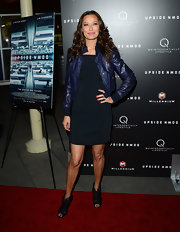 Sky Nellor mixed feminine and masculine looks when she paired this navy cocktail dress with a tough leather jacket.