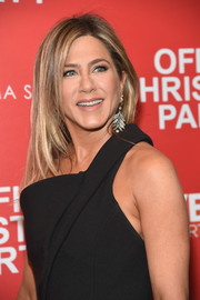 Jennifer Aniston glammed up her plain black outfit with a pair of diamond chandelier earrings by Fred Leighton for the screening of 'Office Christmas Party.'