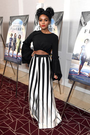 Janelle Monae was cute and hip in a black bell-sleeve crop-top by Christian Siriano at the screening of 'Hidden Figures.'