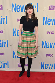 Zooey Deschanel chose this tan and green pleated striped skirt for just a touch of whimsy.