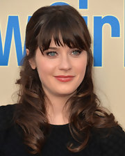 Zooey Deschanel chose a pink lip color with just a touch of coral undertones for a fun summer vibe.