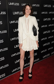 Jena Malone gave her all white look contrast with black suede pumps.
